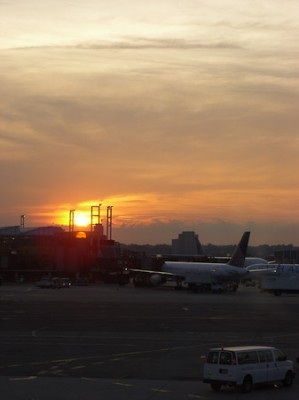 The sun sets over the gates at Newark's Liberty airport while waiting for the Belfast flight to board.
